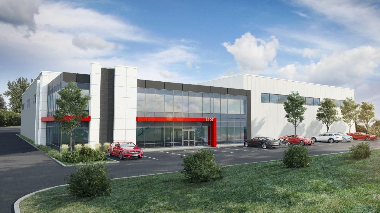un bâtiment industriel à Laval avec une section bureau à l'étage